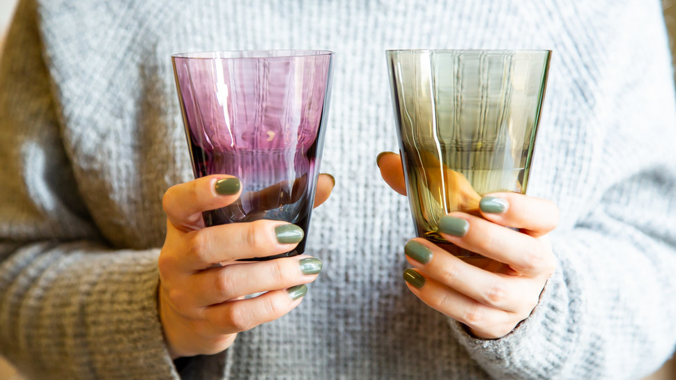 woman-hold-two-tumblers