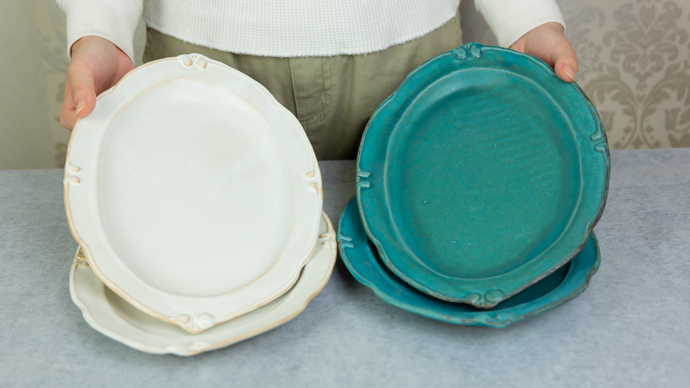 woman-hold-two-plates-of-four